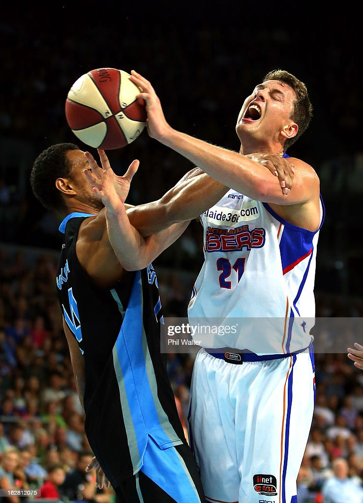 Daniel Johnson of the 36ers runs into Mika Vukona of the Breakers during the round 21 NBL match between the New Zealand Breakers and the Adelaide 36ers at Vector Arena on February 28, 2013 in Auckland, New Zealand.