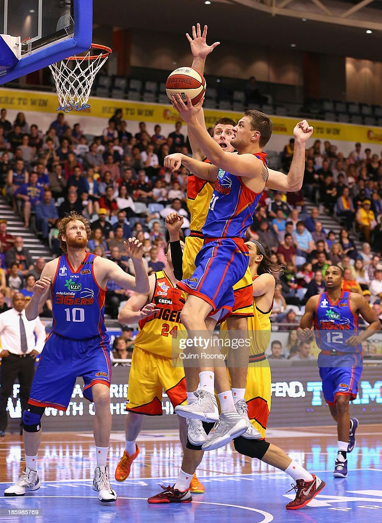 Daniel Johnson of the 36ers shoots during the round three NBL match between the Melbourne Tigers and the Adelaide 36ers at the State Netball Hockey Centre in October 27, 2013 in Melbourne, Australia.
