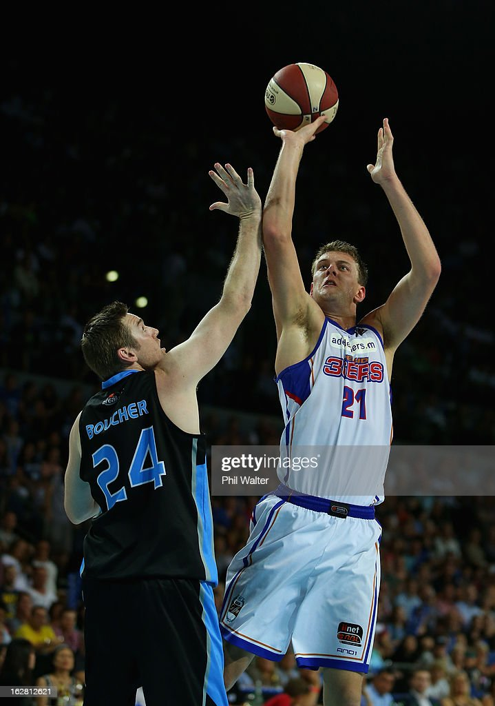 Daniel Johnson of the 36ers shoots over the top of <a gi-track='captionPersonalityLinkClicked' href=/galleries/search?phrase=Dillon+Boucher&family=editorial&specificpeople=731934 ng-click='$event.stopPropagation()'>Dillon Boucher</a> of the Breakers during the round 21 NBL match between the New Zealand Breakers and the Adelaide 36ers at Vector Arena on February 28, 2013 in Auckland, New Zealand.