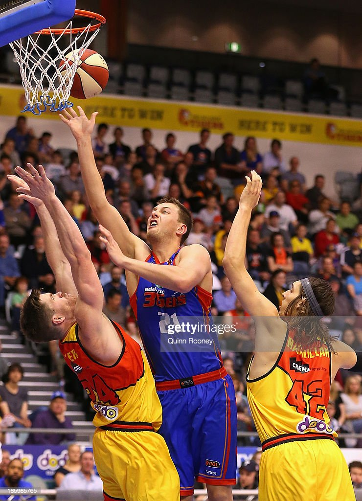 Daniel Johnson of the 36ers shoots over the top of Lucas Walker of the Tigers during the round three NBL match between the Melbourne Tigers and the Adelaide 36ers at the State Netball Hockey Centre in October 27, 2013 in Melbourne, Australia.
