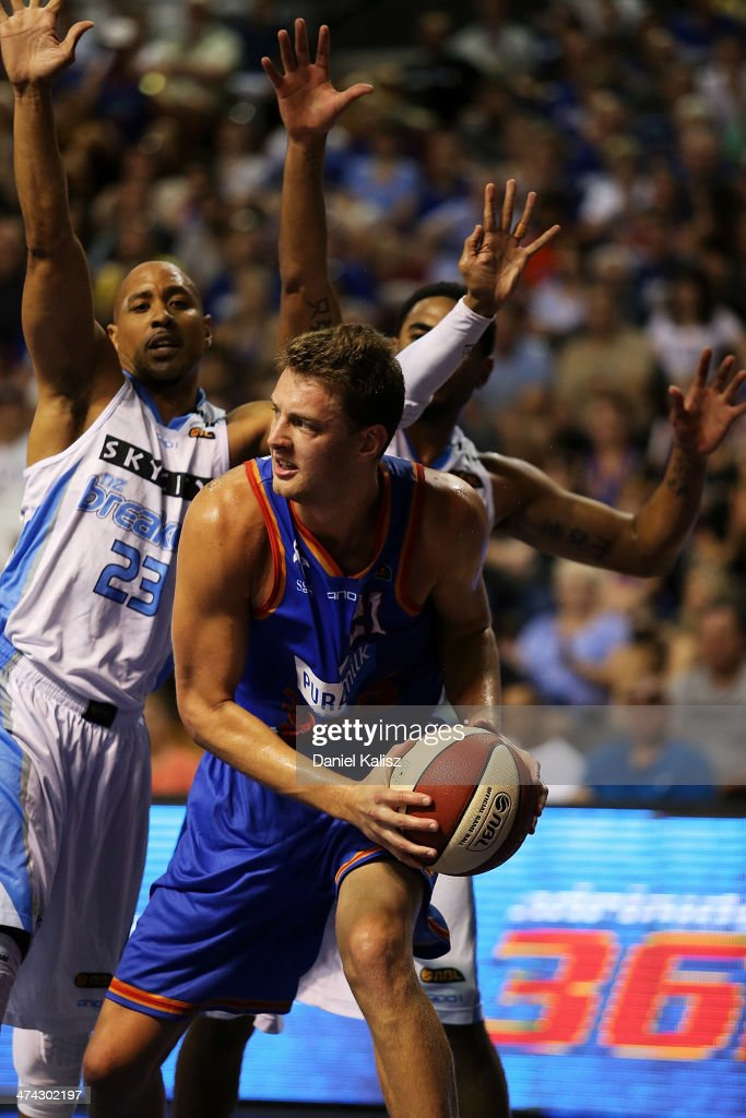 Daniel Johnson of the Sixers looks to pass during the round 19 NBL match between the Adelaide 36ers and the New Zealand Breakers at Adelaide Arena in February 23, 2014 in Adelaide, Australia.
