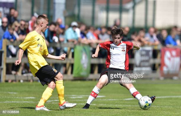 Daniel Jones of Southampton and Darren Hyland of County Antrim during the NI Super Cup junior section game between Southampton and County Antrim at...