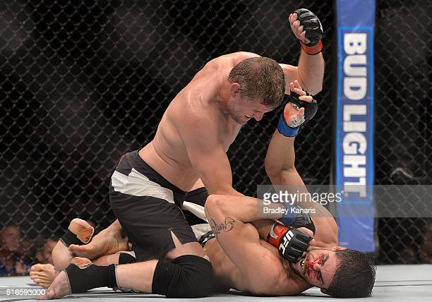 Daniel Kelly grounds and pounds Antonio Carlos Junior during their UFC Middleweight Bout at UFC Brisbane on March 20 2016 in Brisbane Australia