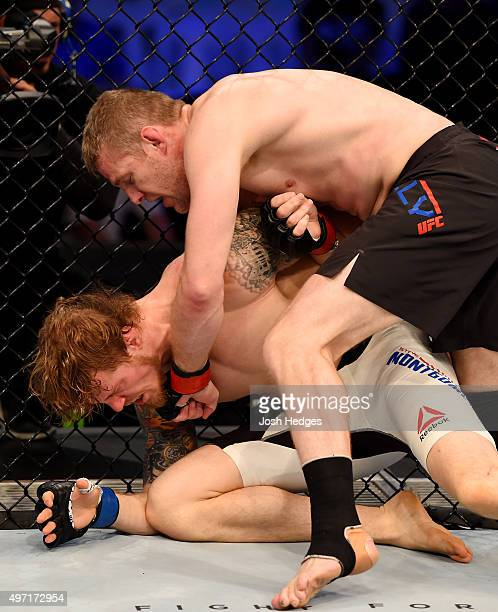 Daniel Kelly lands a lefthanded punch against Steve Montgomery in their middleweight bout during the UFC 193 event at Etihad Stadium on November 15...