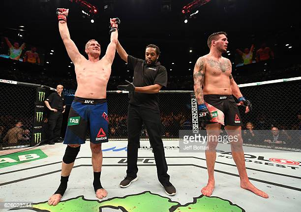 Daniel Kelly of Australia celebrates his unanimousdecision victory over Chris Camozzi in their middleweight bout during the UFC Fight Night event at...