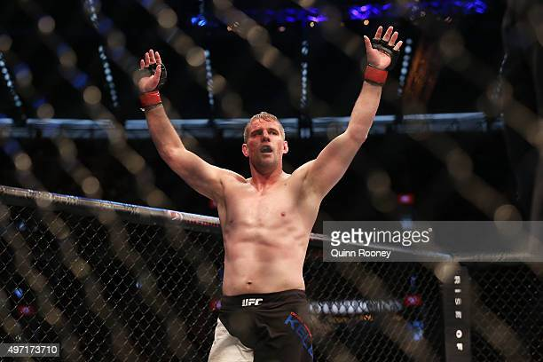 Daniel Kelly of Australia celebrates victory against Steve Montgomery of the United States in their middleweight bout during the UFC 193 event at...