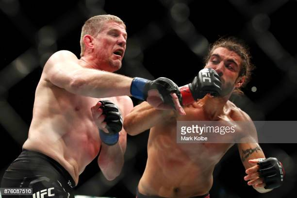 Daniel Kelly of Australia is punched by Elias Theodorou of Canada in their middleweight bout during the UFC Fight Night at Qudos Bank Arena on...