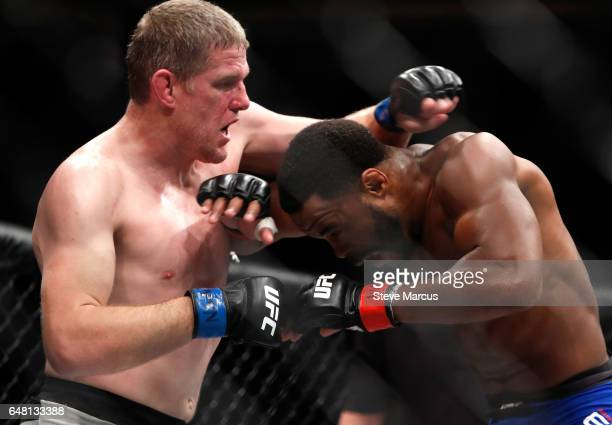Daniel Kelly of Australia mixes it up with Rashad Evans during UFC 209 at TMobile Arena on March 4 2017 in Las Vegas Nevada Kelly won the fight by...