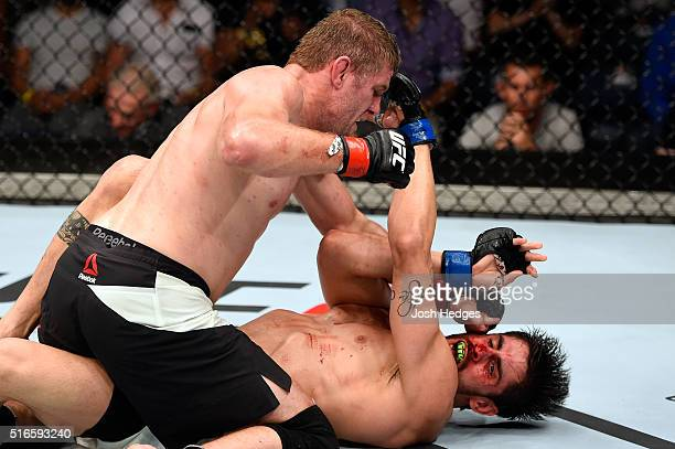 Daniel Kelly of Australia punches Antonio Carlos Junior of Brazil in their middleweight bout during the UFC Fight Night event at the Brisbane...