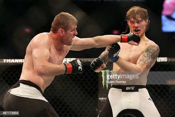 Daniel Kelly of Australia punches Steve Montgomery of the United States in their middleweight bout during the UFC 193 event at Etihad Stadium on...