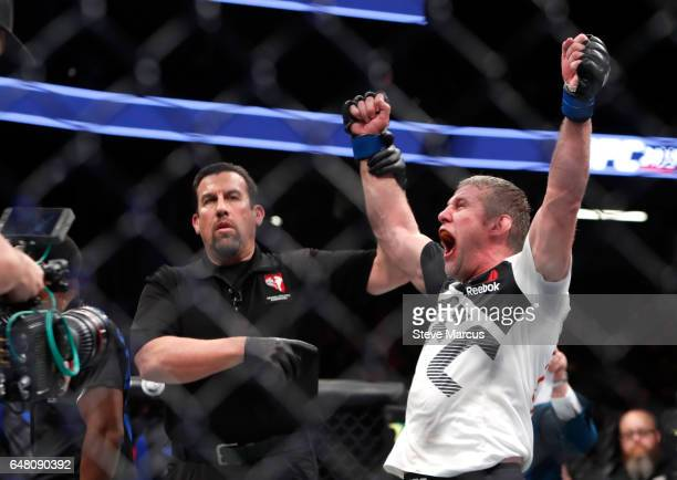 Daniel Kelly of Australia reacts is he is declared the winner by split decision after a middleweight bout against Rashad Evans during UFC 209 at...