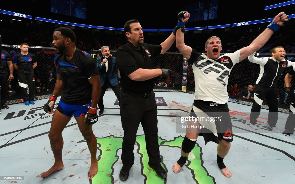 Daniel Kelly of Australia (right) reacts to his victory over Rashad Evans (left) in their middleweight bout during the UFC 209 event at T-Mobile Arena on March 4, 2017 in Las Vegas, Nevada.