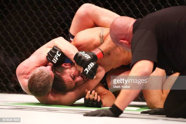 Daniel Kelly of Australia tries to choke out by Elias Theodorou of Canada in their middleweight bout during the UFC Fight Night at Qudos Bank Arena...