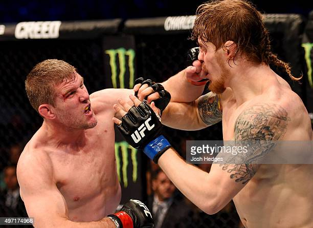 Daniel Kelly throws a lefthanded punch against Steve Montgomery in their middleweight bout during the UFC 193 event at Etihad Stadium on November 15...
