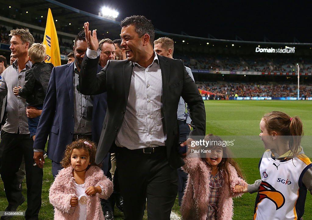 <a gi-track='captionPersonalityLinkClicked' href=/galleries/search?phrase=Daniel+Kerr&family=editorial&specificpeople=215348 ng-click='$event.stopPropagation()'>Daniel Kerr</a> walks a lap of honour with team mates celebrating the West Coast Eagles 2006 Premiership anniversary during the round 15 AFL match between the West Coast Eagles and the Essendon Bombers at Domain Stadium on June 30, 2016 in Perth, Australia.