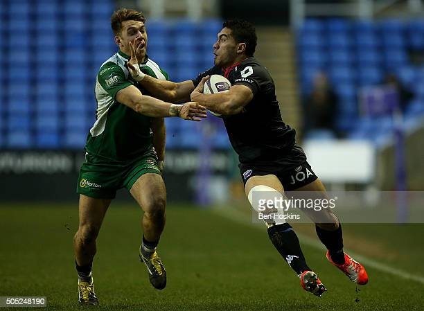 Daniel Kilioni of Grenoble is tackled by Alex Lewington of London Irish during the European Rugby Challenge Cup match between London Irish and...