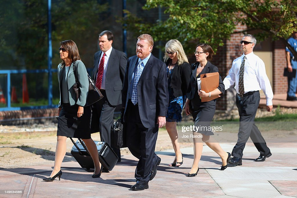Daniel King, chief trial deputy with the Colorado State Public Defender's Office, (C) and other members of the Public Defender's office arrive at the Arapahoe County Courthouse for suspect James Holmes' arraignment hearing July 30, 2012 in Centennial, Colorado. James Holmes, 24, who is accused of killing 12 people and injuring 58 in a shooting spree July 20, during a screening of 'The Dark Knight Rises.' in Aurora, Colorado.