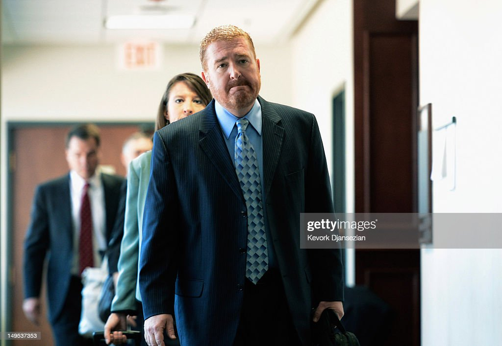 Daniel King (R), chief trial deputy with the Colorado State Public Defender's Office, leave after the arraignment of accused theater gunman James Holmes the Arapahoe County Courthouse July 30, 2012 in Centennial, Colorado. Holmes is charged with 24 counts of murder and 116 counts of attempted murder in the July 20, shooting rampage at an opening night screening of 'The Dark Knight Rises' in Aurora, Colorado.