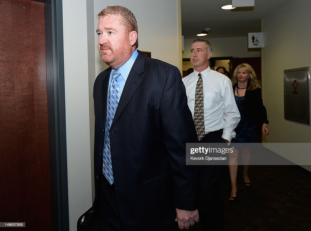 Daniel King (R), chief trial deputy with the Colorado State Public Defender's Office, arrives at the Arapahoe County Courthouse for the arraignment of accused theater gunman James Holmes July 30, 2012 in Centennial, Colorado. Holmes is charged with 24 counts of murder and 116 counts of attempted murder in the July 20, shooting rampage at an opening night screening of 'The Dark Knight Rises' in Aurora, Colorado.