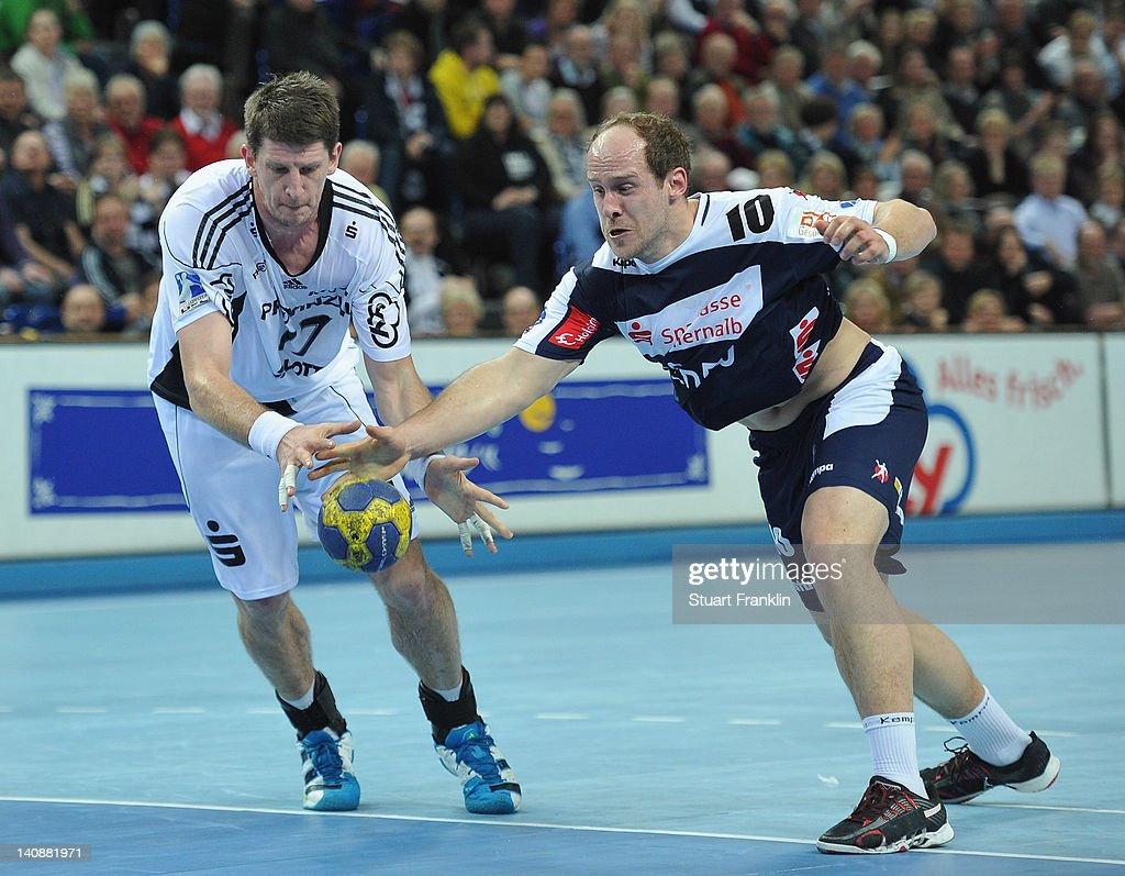 Daniel Kubes of Kiel is challenged by Roland Schlinger of Balingen during the Toyota Bundesliga match between THW Kiel and HBW Balingen-Weilstetten at the Sparkassen Arena on March 7, 2012 in Kiel, Germany.