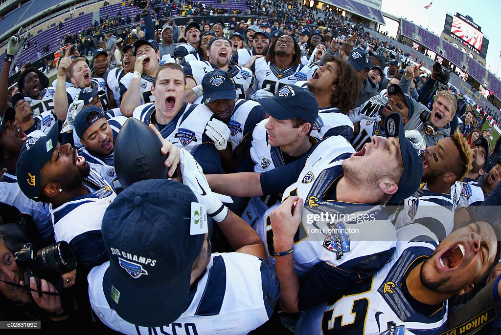 Daniel Lasco of the California Golden Bears and Jared Goff of the California Golden Bears celebrate with the championship trophy after beating the...