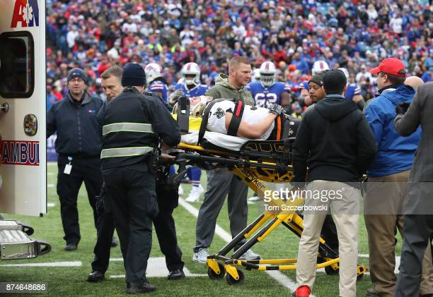 Daniel Lasco of the New Orleans Saints is taken off the field by paramedics on a stretcher as he is loaded into an ambulance after sustaining a disc...