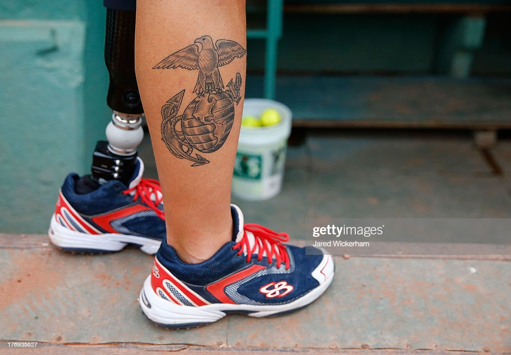 Daniel Lasko of the Wounded Warriors Amputee softball team is shown with a USMC tattoo prior to the game against the Boston Marathon first responders...