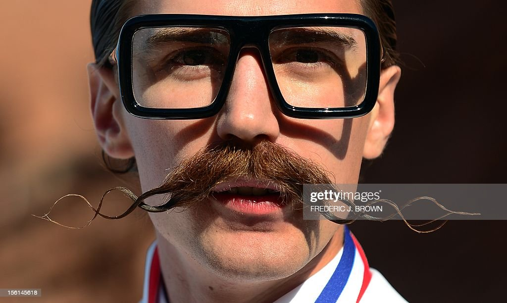 Daniel Lawlor from Los Angeles, California, poses after winning first place in the Freestyle Moustache category at the third annual National Beard and Moustache Championships in Las Vegas, Nevada on November 11, 2012. AFP PHOTO / Frederic J. BROWN