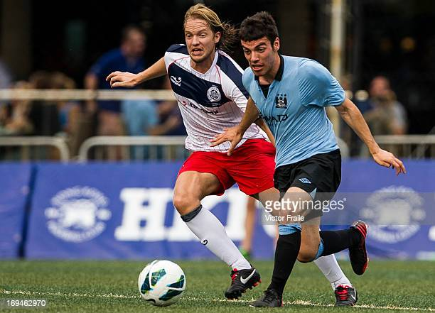 Daniel Lema of Manchester City and Tem Hansen of Yau Yee League Select fight for the ball on day two of the Hong Kong International Soccer Sevens at...