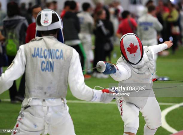 Daniel Li attacks Brandon Jalowica during semifinal action the Junior Men's Foil event on April 21 2017 at the Canadian National Fencing...