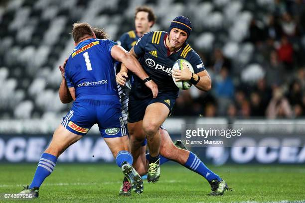 Daniel LienertBrown of the Highlanders fends off Oli Kebble of the Stormers during the round 10 Super Rugby match between the Highlanders and the...