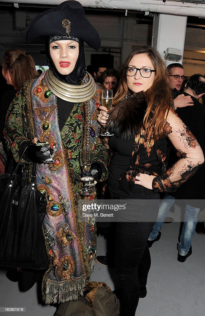 Daniel Lismore (L) and guest attend the launch of artist Dinos Chapman's first album 'Luftbobler' at The Vinyl Factory on February 27, 2013 in London, England.