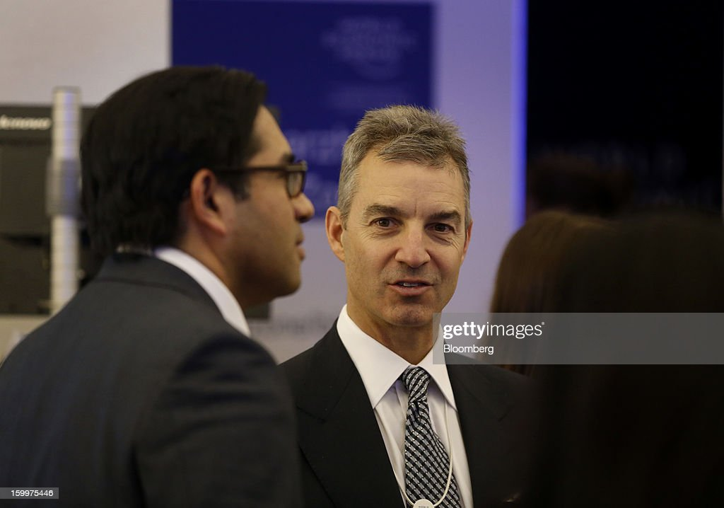 Daniel Loeb, chief executive officer of Third Point LLC, center, speaks with fellow attendees between sessions on day two of the World Economic Forum (WEF) in Davos, Switzerland, on Thursday, Jan. 24, 2013. World leaders, influential executives, bankers and policy makers attend the 43rd annual meeting of the World Economic Forum in Davos, the five day event runs from Jan. 23-27. Photographer: Simon Dawson/Bloomberg via Getty Images