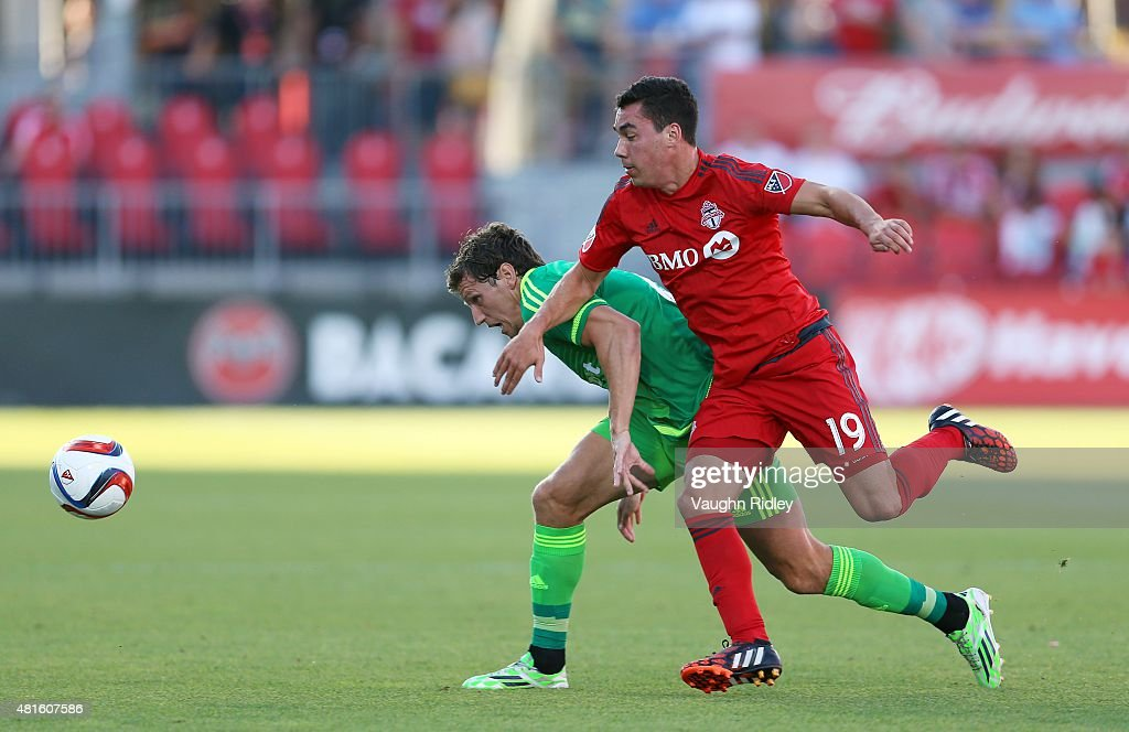 Daniel Lovitz #19 of Toronto FC and Billy Jones #2 of Sunderland AFC battle for the ball during a friendly match at BMO Field on July 22, 2015 in Toronto, Ontario, Canada.