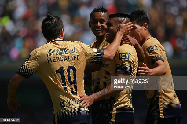 Daniel Ludueña of Pumas celebrates with his teammates after scoring the first goal of his team during the 7th round match between Pumas UNAM and...