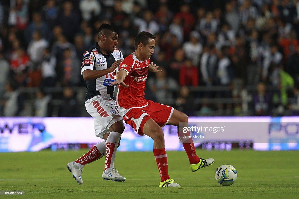 Daniel Luduena (L) of Pachuca struggles for the ball with Gerardo Rodriguez (R) of Toluca during the Clausura 2013 Liga MX at Hidalgo Stadium on february 2, 2013 in Pachuca, Mexico.