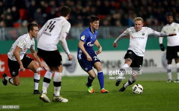 Daniel Lukasik of Sandhausen and Klaas Jan Huntelaar of Schalke battle for the ball during the DFB Cup Round of16 match between SV Sandhausen and FC...