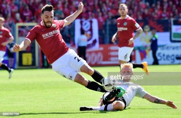 Daniel Lukasik of Sandhausen challanges against Kenan Karaman of Hannover during the Second Bundesliga match between SV Sandhausen and Hannover 96 at...