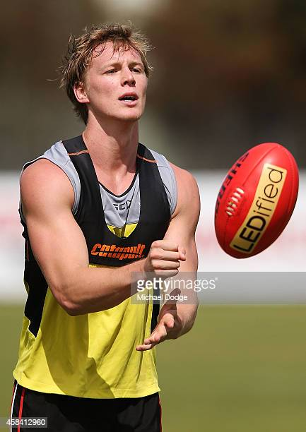 Daniel Markworth handballs during a StKilda Saints AFL training session at Linen House Oval on November 5 2014 in Melbourne Australia