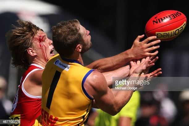 Daniel Markworth with blood running down his face contests for the ball against Luke Delaney during a St Kilda Saints AFL intraclub match at Linen...