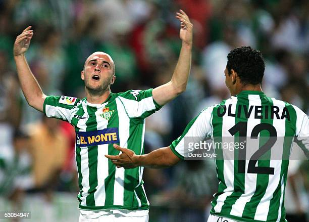 Daniel Martin Alexandre 'Dani' #6 of Real Betis celebrates with teammate Ricardo Oliveira after scoring the winning goal in the Kings Cup final...