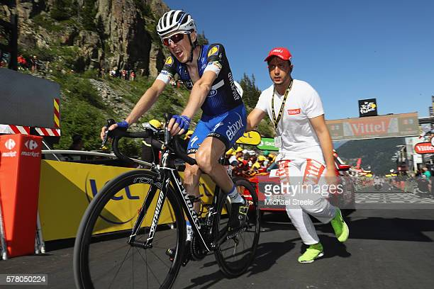 Daniel Martin of Ireland and EtixxQuickStep is given a helping push after crossing the finishing line during the 1845km stage seventeen of Le Tour de...