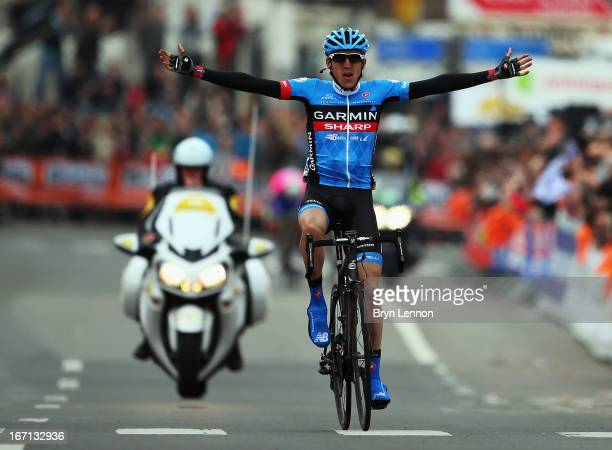 Daniel Martin of Ireland and GarminSharp crosses the finish line to win the 99th LiegeBastogneLiege road race on April 21 2013 in Liege Belgium