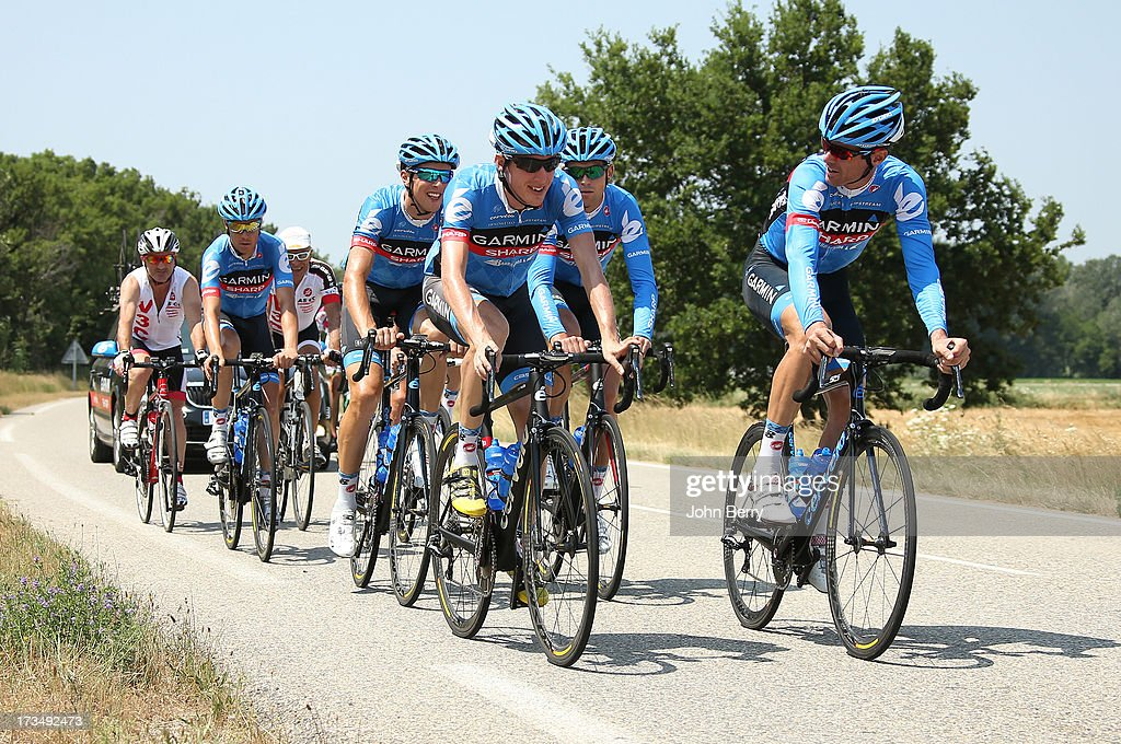 Daniel Martin of Ireland and Team Garmin-Sharp and David Millar of Great Britain lead their teammates during the second rest day of the 2013 Tour de France on July 15, 2013 in Orange, Vaucluse, France.