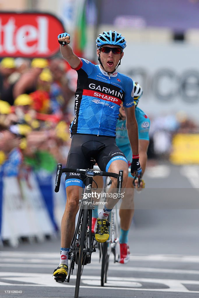 Daniel Martin of Ireland and Team Garmin-Sharp celebrates winning the stage as he crosses the finish line during stage nine of the 2013 Tour de France, a 168.5KM road stage from Saint-Girons to Bagneres-de-Bigorre, on July 7, 2013 in Bagneres-de-Bigorre, France.