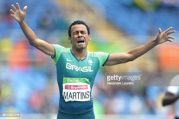 Daniel Martins of Brazil celebrates after winning the Men's 400m T20 Final at the Olympic Stadium on Day 2 of the Rio 2016 Paralympic Games on...