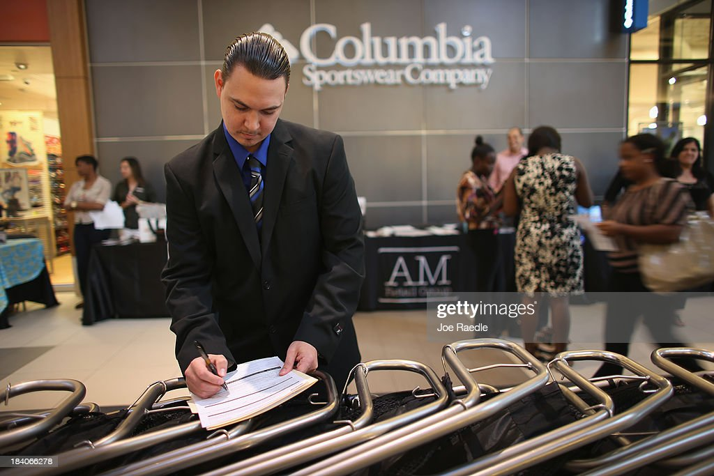 Daniel Mastrianni fills out a job application form as he applies for jobs during a job fair at Sawgrass Mills on October 11, 2013 in Sunrise, Florida. As the holiday season approaches many of the roughly 50 retailers at the job fair including Banana Republic, J.Crew Factory, Victoria's Secret and Calvin Klein are starting to hire people for seasonal work as well as continuing to look for qualified full time employees.