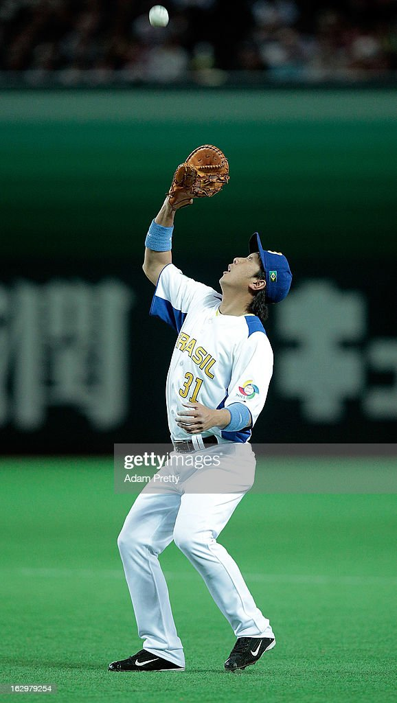 Daniel Matsumoto of Brazil takes a catch during the World Baseball Classic First Round Group A game between Brazil and Japan at Fukuoka Yahoo! Japan Dome on March 2, 2013 in Fukuoka, Japan.