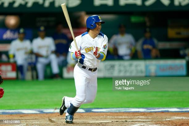Daniel Matsumoto of Team Brazil hits a RBI single in the bottom of the sixth inning during Pool A Game 2 between Team Cuba and Team Brazil during the...