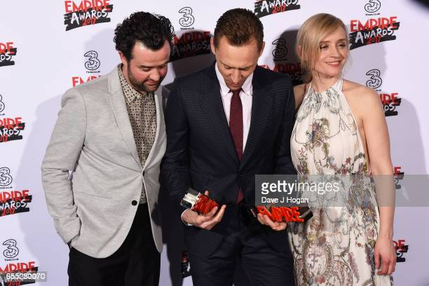 Daniel Mays Tom Hiddleston and AnneMarie Duff pose with the awards for Empire Hero and Best TV Series The Night Manager in the winners room at the...